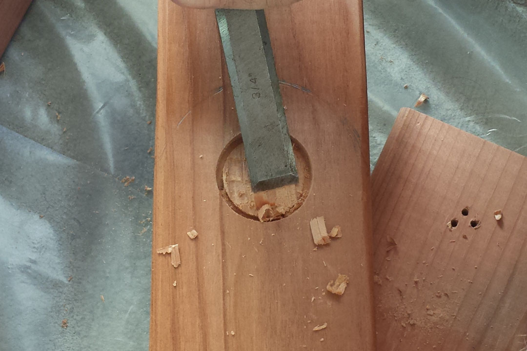 chiseling the hole for the hinges