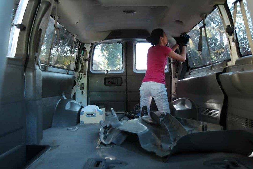 Christine removing plastic trim in van