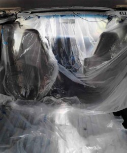 van covered with plastic sheeting