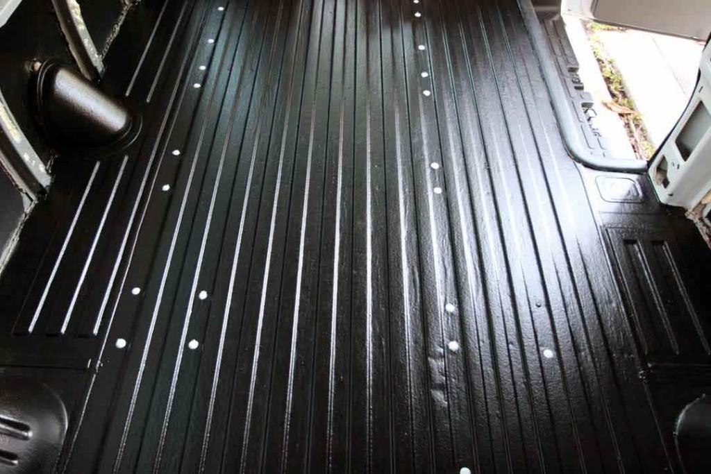holes in van floor covered with caps