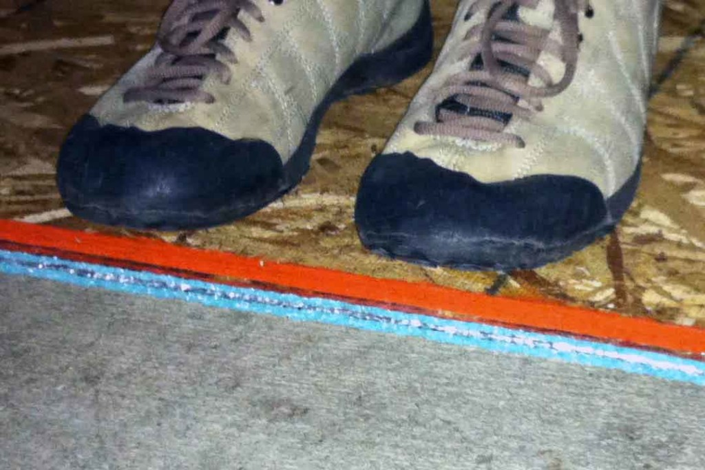 standing on a piece of wood on top of two layers of insulation