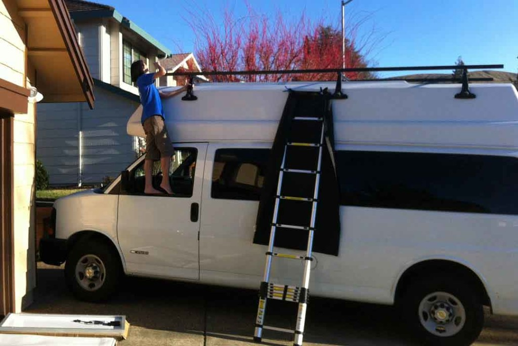van with high top with roof rack for solar panels
