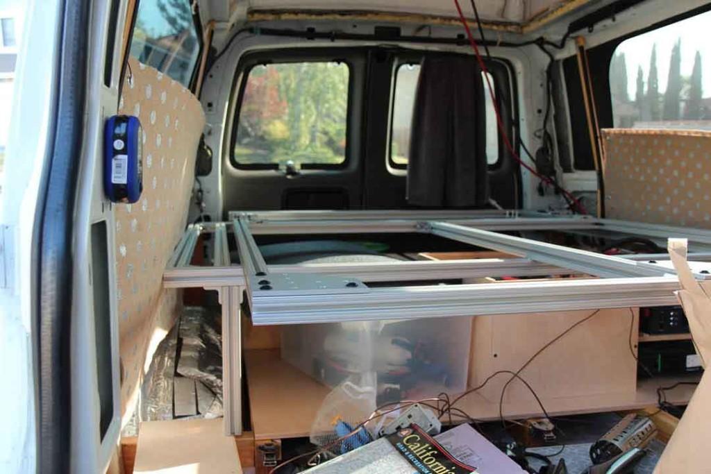 Custom bed frame inside the van