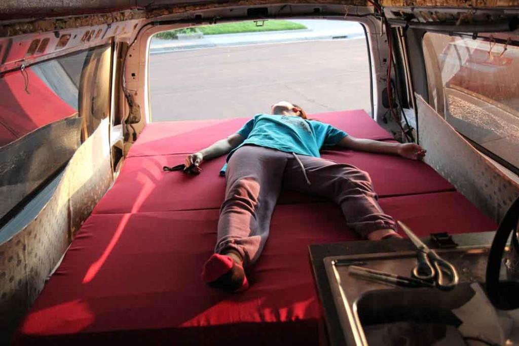 bed with mattress inside van