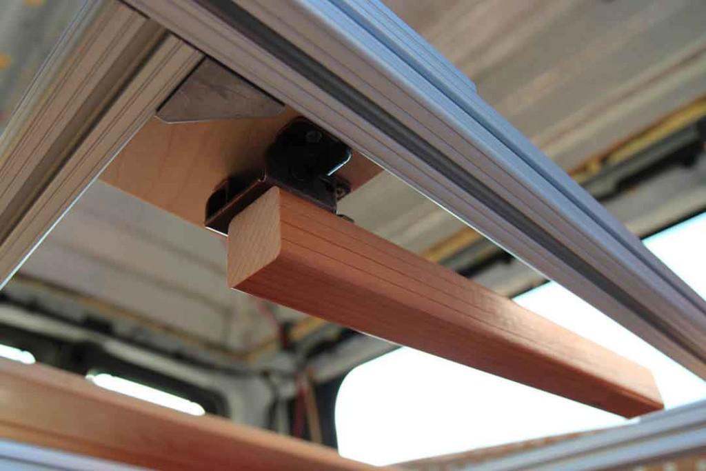 Folding leg for bed inside van