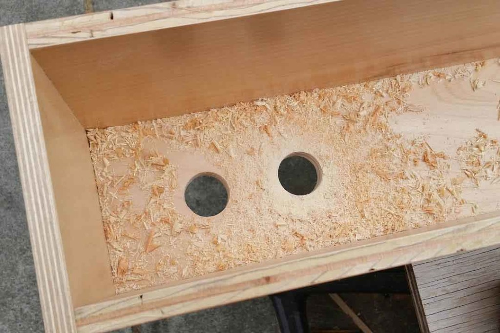 Holes in the bottom of the wood boxes