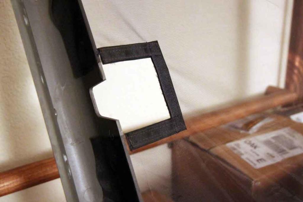 Cutout in screen for latch