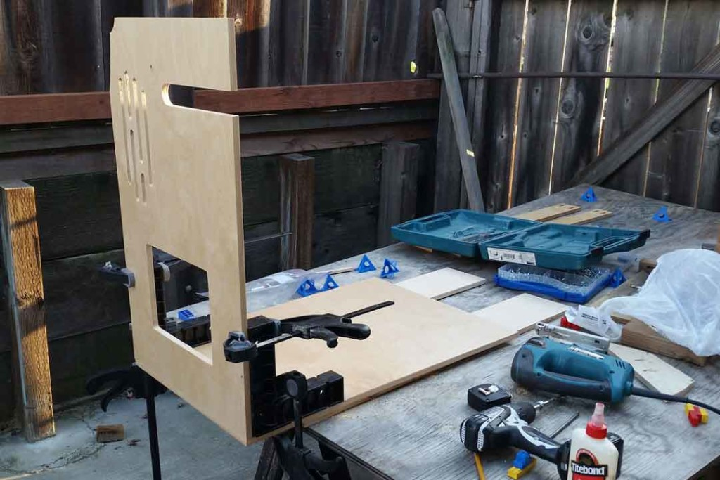 Assembling the table with clamps and squares