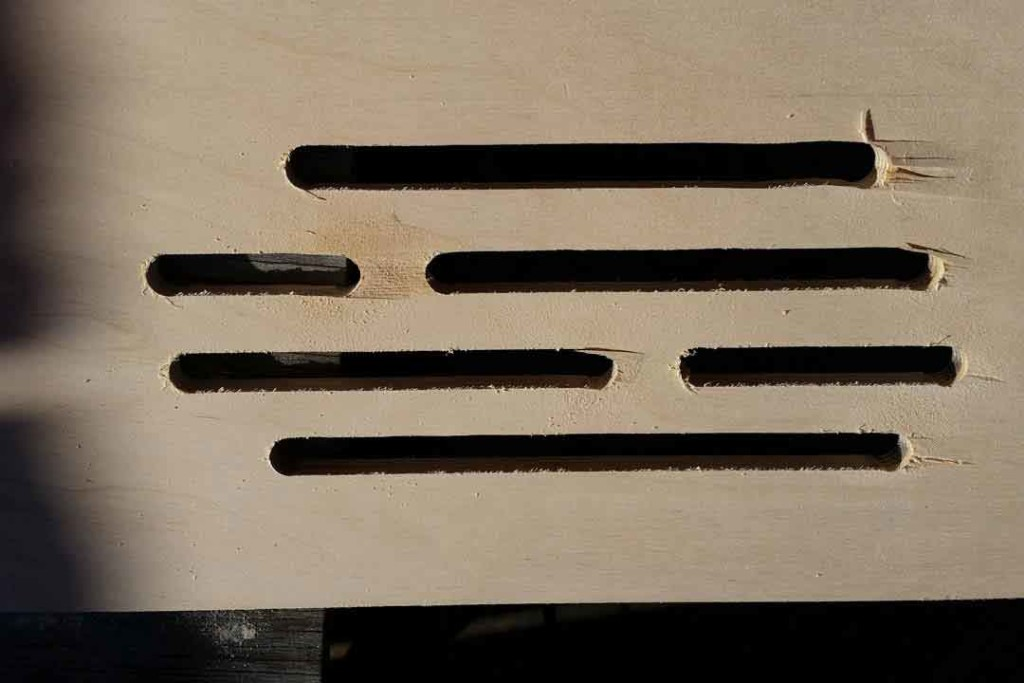 Holes in wood made by the plunge router