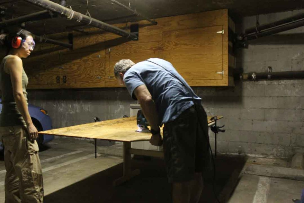 cutting the subfloor with a jig saw