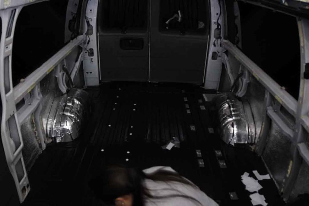 cover holes in van floor with caps and sound deadening