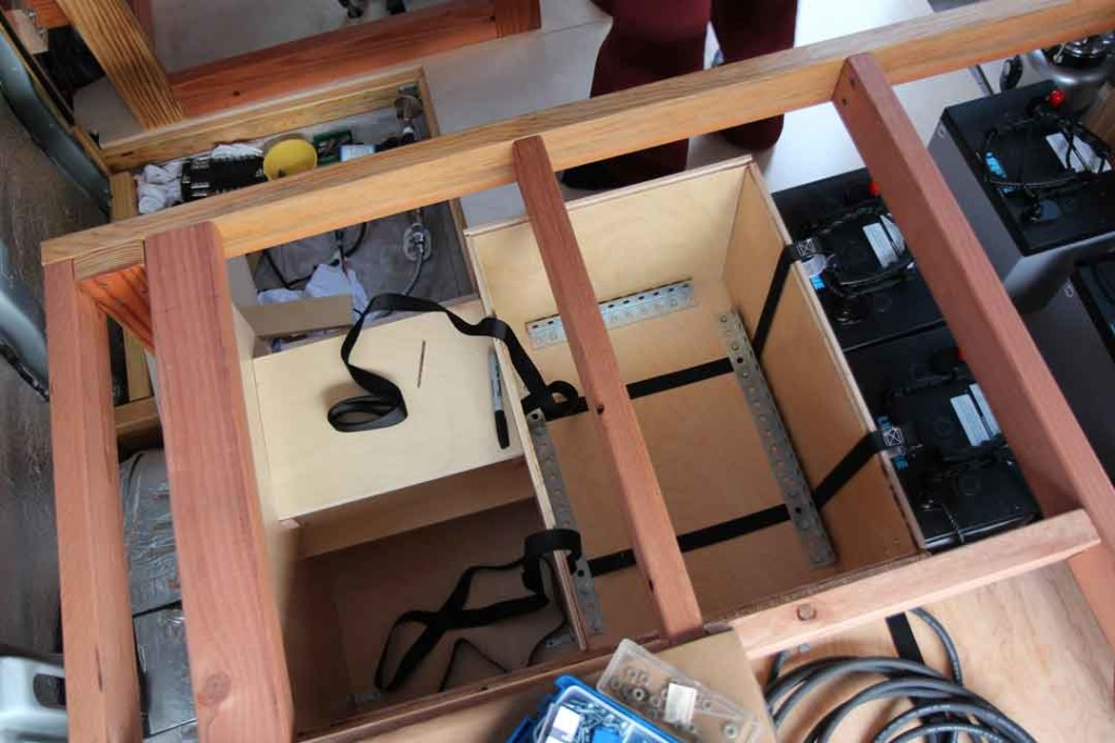 Box in van for batteries and electrical components