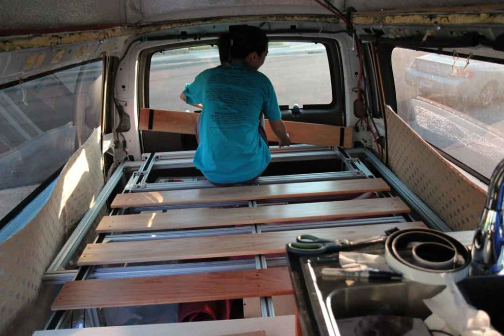 Installing the bed slats inside the van