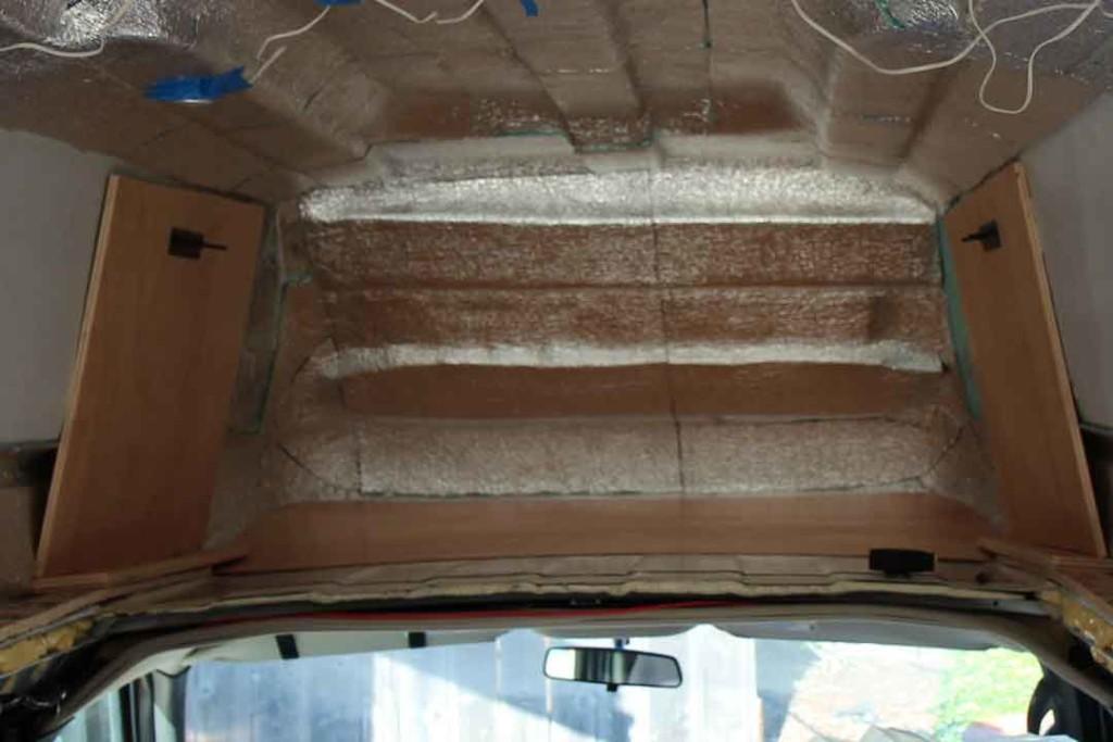 Plywood backing the fiberglass high top for the Thule rack