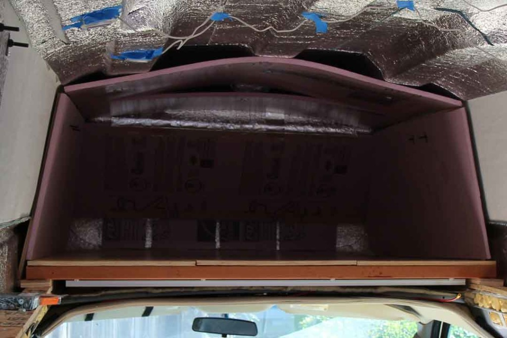 Pink rigid foam insulation in van storage area