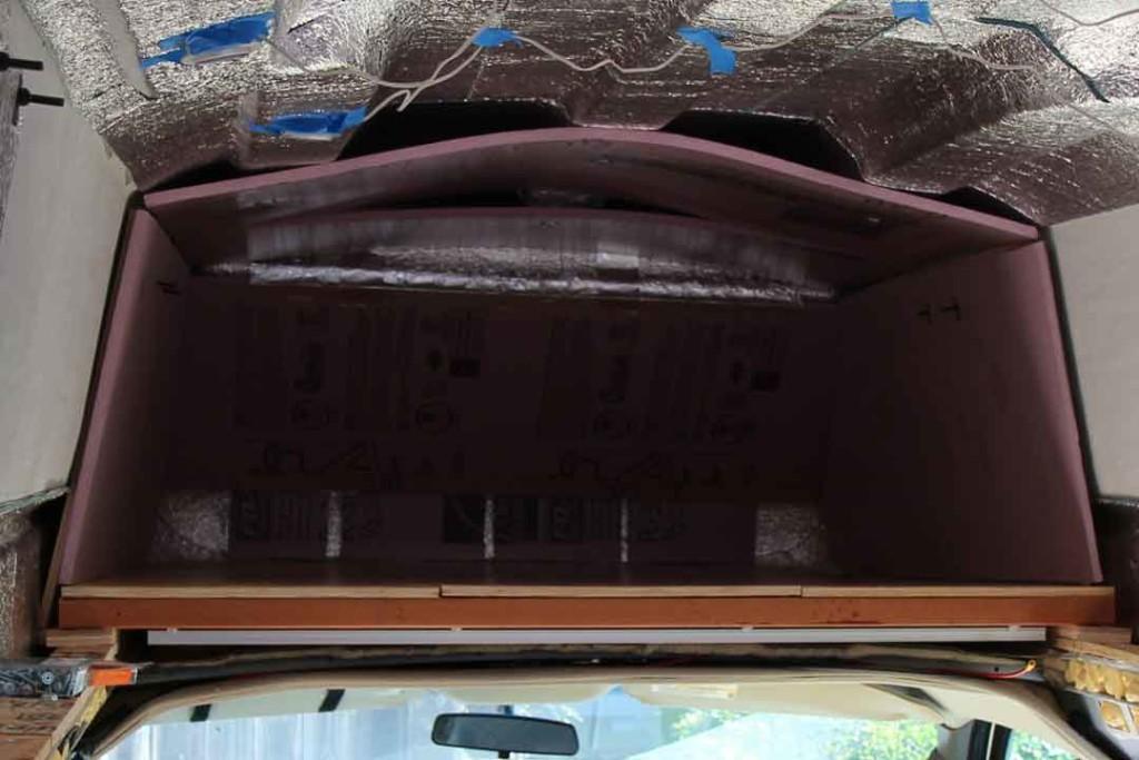 Pink rigid foam insulation in van storage area